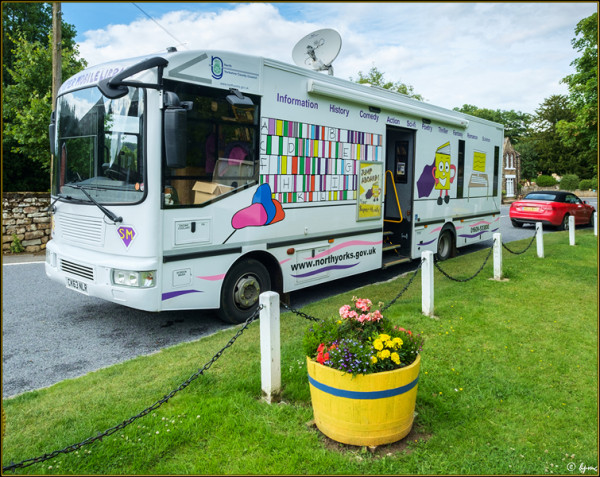 The Super Mobile Library van parked by the village green.