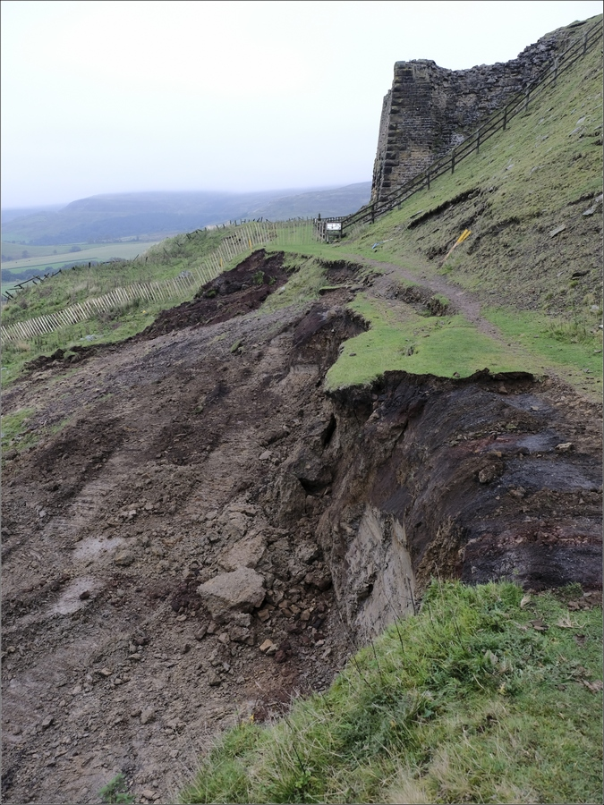 Digging away the old loose earth from the landslip