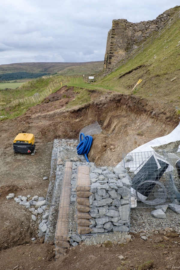 Building up the gabions.
